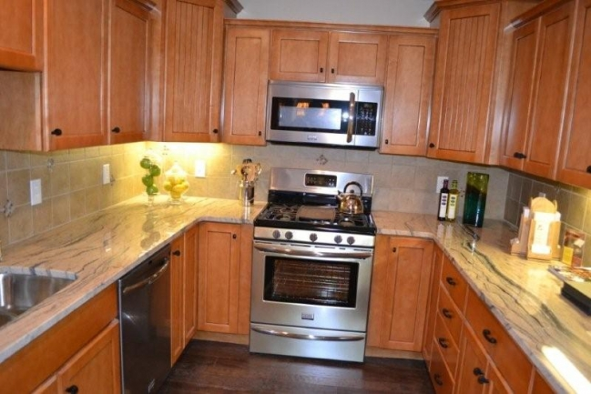 Easy flow kitchen with stainless appliances.